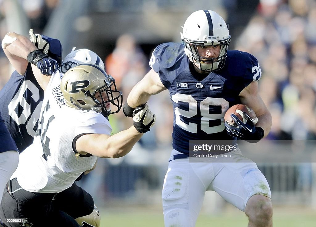 Zach Zwinak of Penn State runs down the field with the ball past Jake Replogle of Purdue. The Penn State Nittany Lions defeated the Purdue Boilermakers, 45-21, at Beaver Stadium in State College, Pa., on Saturday, Nov. 16, 2013.