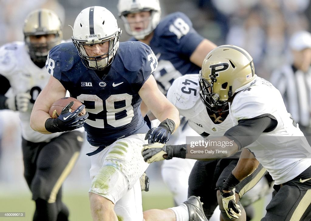 Zach Zwinak of Penn State runs the ball against Taylor Richards of Purdue. The Penn State Nittany Lions defeated the Purdue Boilermakers, 45-21, at Beaver Stadium in State College, Pa., on Saturday, Nov. 16, 2013.