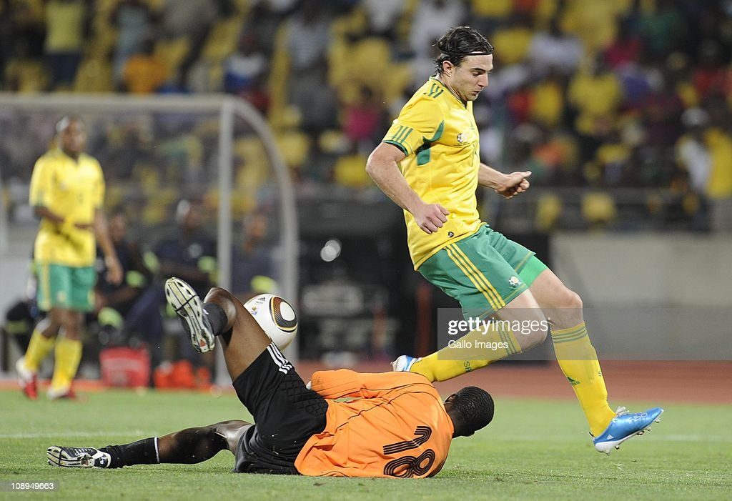 Zacharia Onyango and Davide Sooma during the International friendly match between South Africa and Kenya at Royal Bafokeng Stadium on February 09, 2011 in Rustenburg, South Africa.