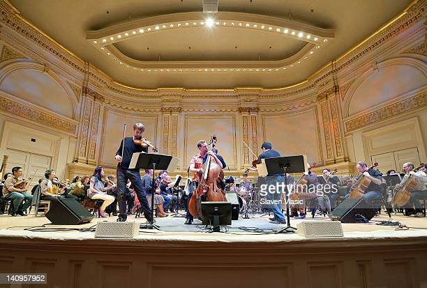 Zachary De Pue violin Ranaan Meyer double bass and Nicolas Kendall violin with Boston Pops Orchestra perform during Tanglewood's 75th anniversary...