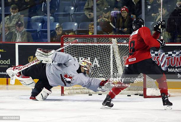 Zachary Fucale attempts to make a save from Rourke Chartier during the Canada National Junior Team practice at the Meridian Centre on December 16...