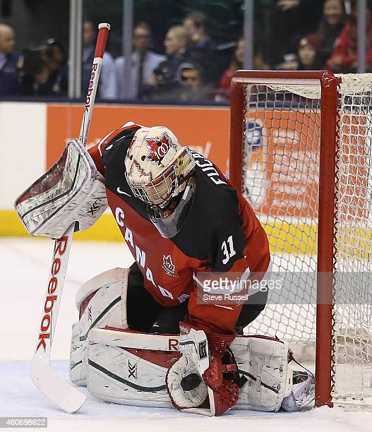 TORONTO ON DECEMBER 19 Zachary Fucale makes a stop in second period action as the Team Canada plays Team Russia in a 2015 IIHF World Junior...