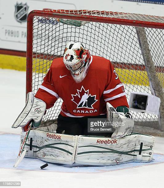 Zachary Fucale of Team Canada makes a save against Team Sweden during the 2013 USA Hockey Junior Evaluation Camp at the Lake Placid Olympic Center on...