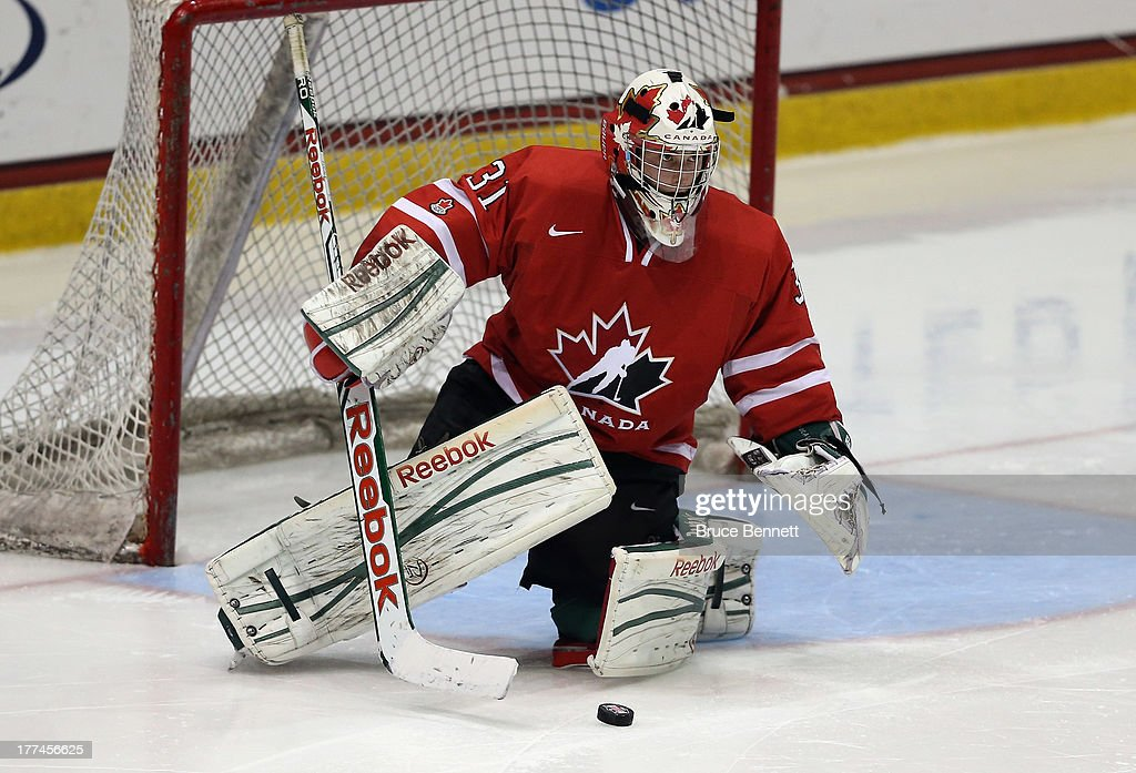 <a gi-track='captionPersonalityLinkClicked' href=/galleries/search?phrase=Zachary+Fucale&family=editorial&specificpeople=9959699 ng-click='$event.stopPropagation()'>Zachary Fucale</a> #31 of Team Canada skates against Team Sweden during the 2013 USA Hockey Junior Evaluation Camp at the Lake Placid Olympic Center on August 8, 2013 in Lake Placid, New York.