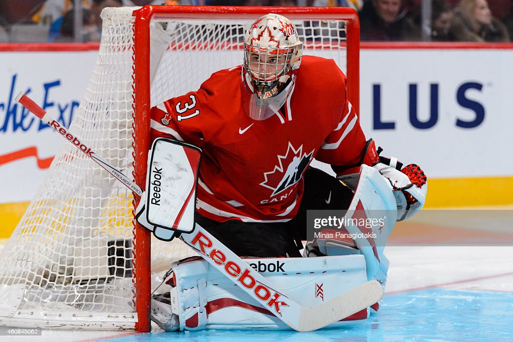 <a gi-track='captionPersonalityLinkClicked' href=/galleries/search?phrase=Zachary+Fucale&family=editorial&specificpeople=9959699 ng-click='$event.stopPropagation()'>Zachary Fucale</a> #31 of Team Canada watches the play during the 2015 IIHF World Junior Hockey Championship exhibition game against Team Switzerland at the Bell Centre on December 23, 2014 in Montreal, Quebec, Canada. Team Canada defeated Team Switzerland 6-0.
