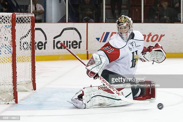 Zachary Fucale of the Halifax Mooseheads makes a save against the Gatineau Olympiques on October 24 2014 at Robert Guertin Arena in Gatineau Quebec...