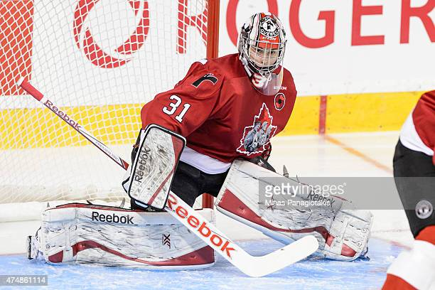 Zachary Fucale of the Quebec Remparts follows the play in Game One during the 2015 Memorial Cup against the Kelowna Rockets at the Pepsi Coliseum on...