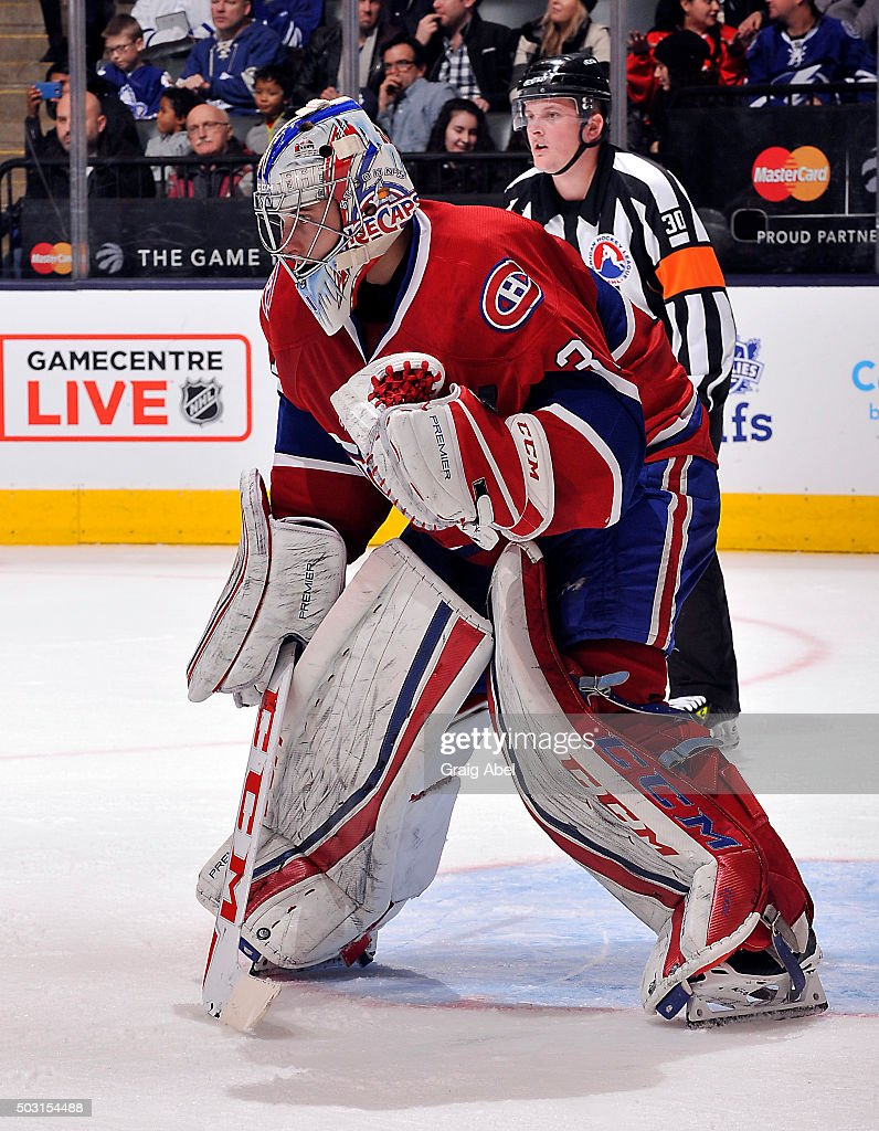<a gi-track='captionPersonalityLinkClicked' href=/galleries/search?phrase=Zachary+Fucale&family=editorial&specificpeople=9959699 ng-click='$event.stopPropagation()'>Zachary Fucale</a> #31 of the St. Johns IceCaps prepares for a shot against the Toronto Marlies during AHL game action on December 26, 2015 at Air Canada Centre in Toronto, Ontario, Canada.