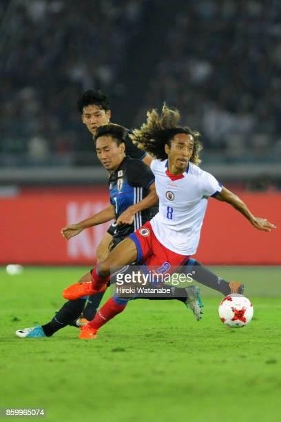 Zachary Herivaux of Haiti controls the ball under pressure of Shu Kurata of Japan during the international friendly match between Japan and Haiti at...