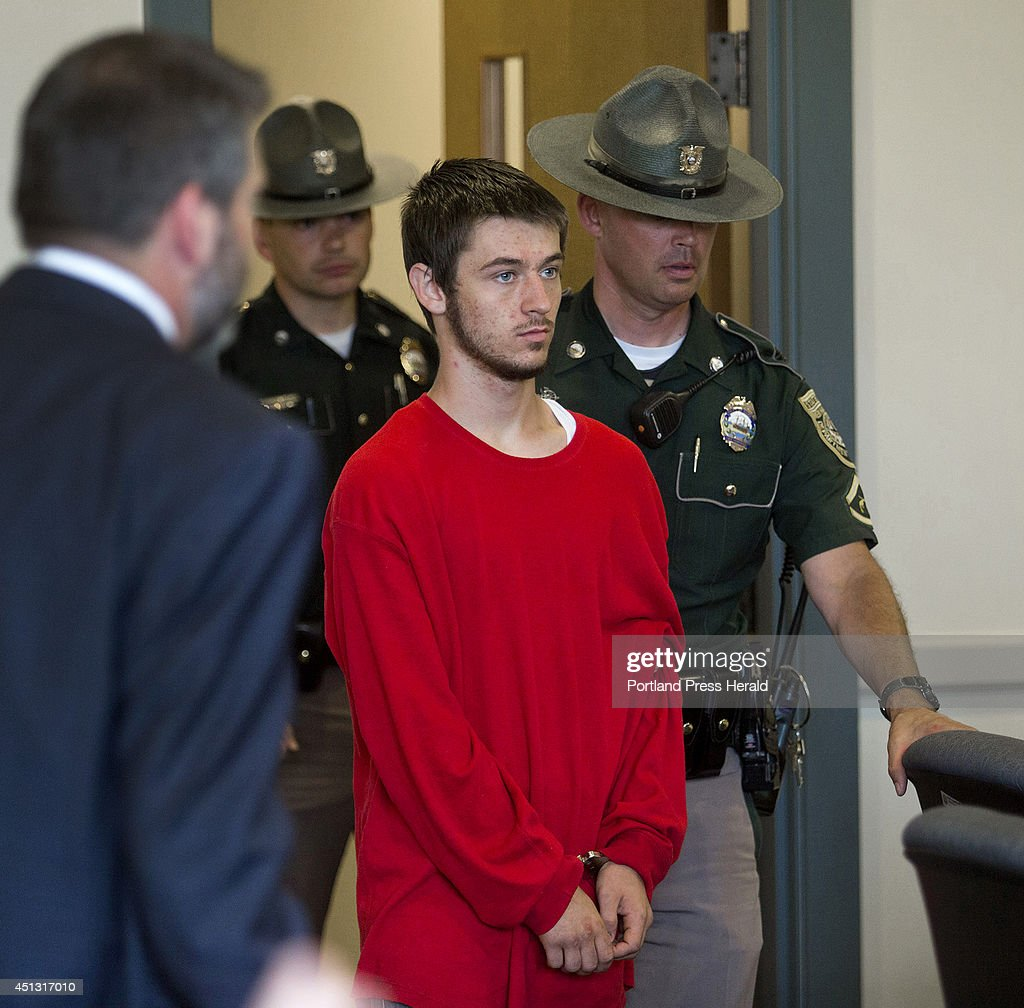 Zachary Pinette, 18, of Springvale, is led into 7th circuit court in Dover, N.H. Thursday, June 26, 2014, to be arraigned on charges of first degree murder for causing the death of Aaron Wilkinson, 18, of Madbury, N.H. Wilkinson's body was found in Lebanon, Maine.