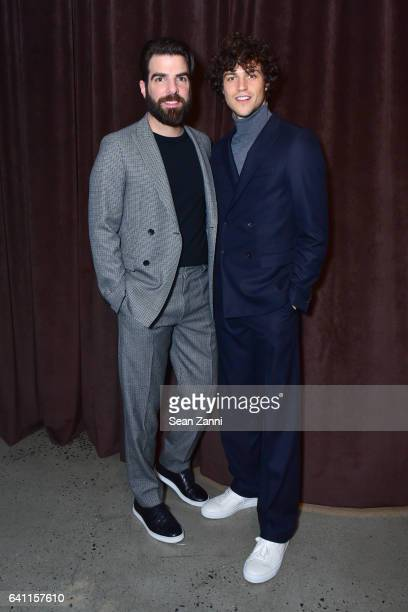 Zachary Quinto and Miles McMillan attend Boss Front Row NYFW Men's at Skylight Modern on January 31 2017 in New York City
