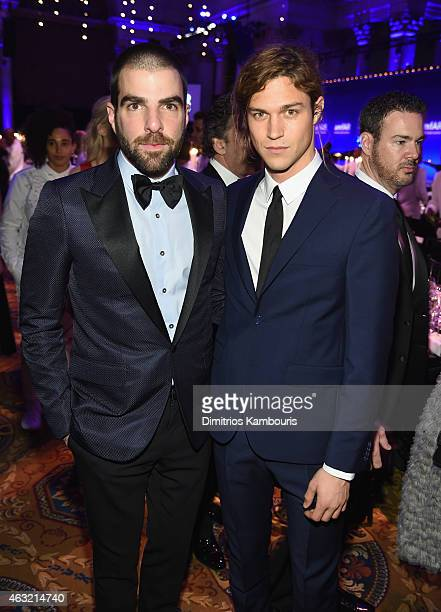 Zachary Quinto and Miles McMillan attend the 2015 amfAR New York Gala at Cipriani Wall Street on February 11 2015 in New York City