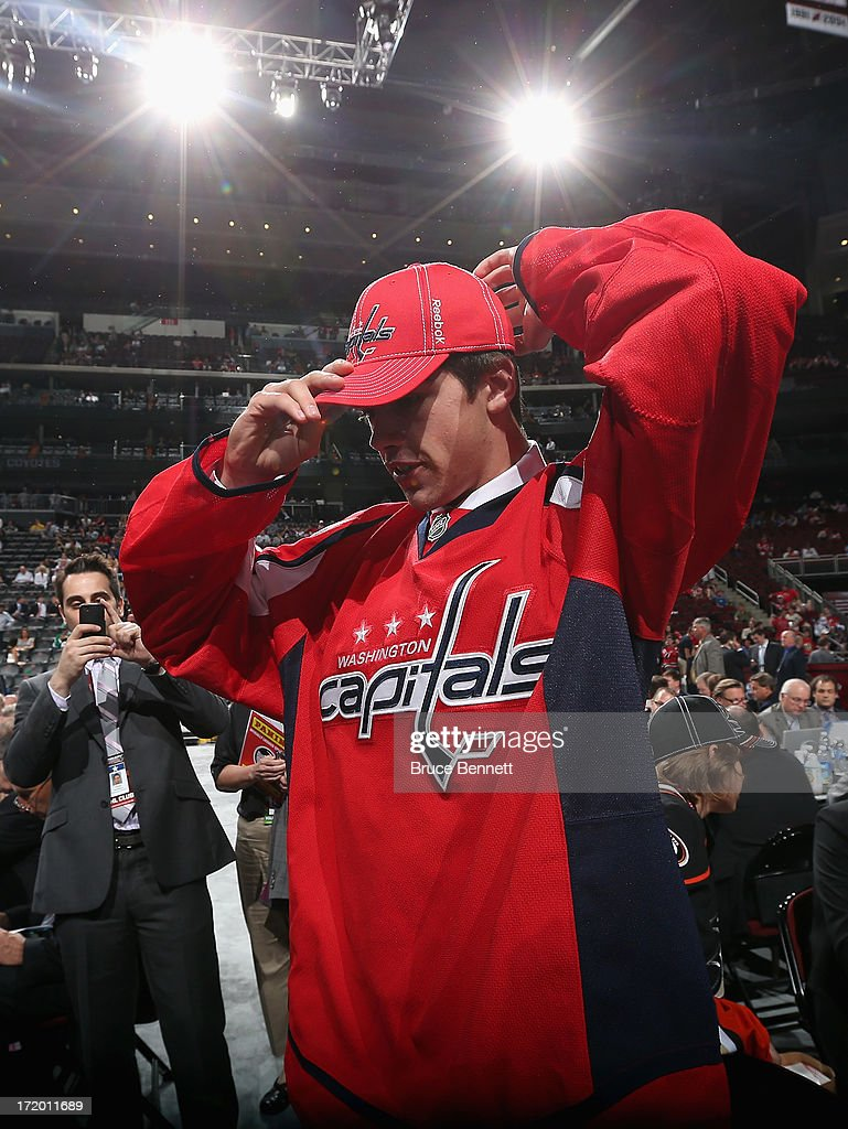 Zachary Sanford adjusts his hat after he was drafted #61 overall in the second round by the Washington Capitals during the 2013 NHL Draft at the Prudential Center on June 30, 2013 in Newark, New Jersey.