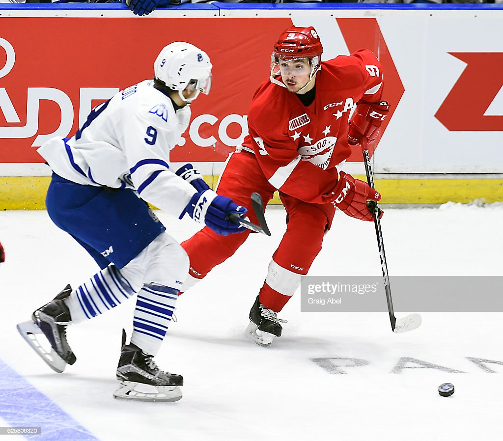 Zachary Senyshyn #9 of the Sault Ste. Marie Greyhounds controls the puck against Michael McLeod #9 of the Mississauga Steelheads during game action on November 25, 2016 at Hershey Centre in Mississauga, Ontario, Canada.
