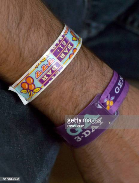 Zachary Snobel of Nevada wears his Route 91 Harvest wrist passes as he attends a prayer vigil held at Mountain Crest Park for the victims of Sunday...