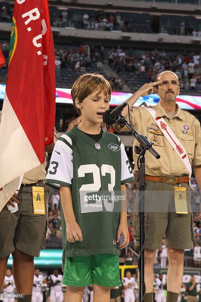 Zachary Unger of the Broadway Show 'Big Fish' performs the National Anthem before The Jacksonville Jaguars Vs. New York Jets Pre-Season NFL Game at MetLife Stadium on August 17, 2013 in East Rutherford, New Jersey.