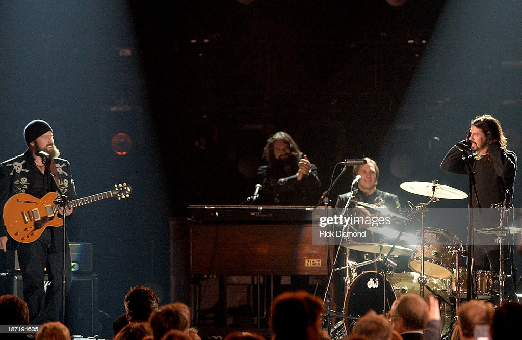 Zack Brown and <a gi-track='captionPersonalityLinkClicked' href=/galleries/search?phrase=Dave+Grohl&family=editorial&specificpeople=202539 ng-click='$event.stopPropagation()'>Dave Grohl</a> perform onstage during the 47th annual CMA Awards at the Bridgestone Arena on November 6, 2013 in Nashville, Tennessee.