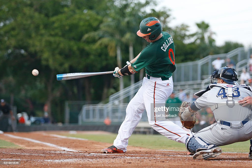 Zack Collins of the Miami Hurricanes hits a single scoring a run in the first inning against the Pittsburgh Panthers on May 14 2016 at Alex Rodriguez...