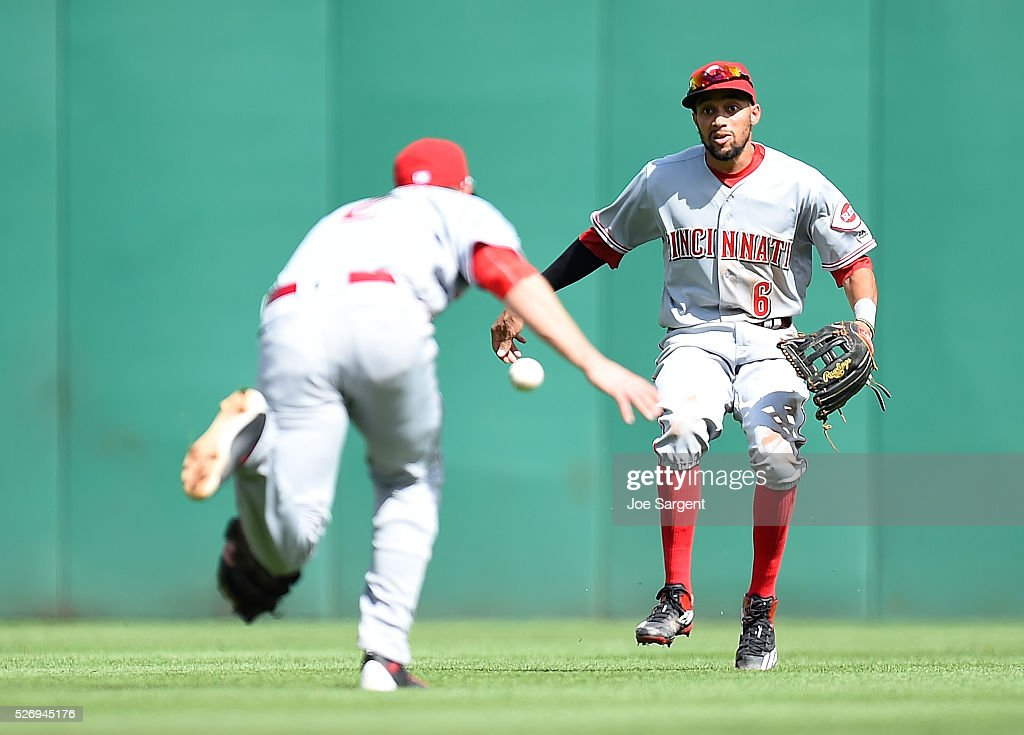 Zack Cozart #2 and Billy Hamilton #6 of the Cincinnati Reds can't make a catch on a ball hit by Matt Joyce #17 of the Pittsburgh Pirates (not pictured) on May 1, 2016 at PNC Park in Pittsburgh, Pennsylvania.
