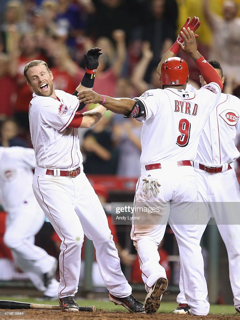 <a gi-track='captionPersonalityLinkClicked' href=/galleries/search?phrase=Zack+Cozart&family=editorial&specificpeople=6889199 ng-click='$event.stopPropagation()'>Zack Cozart</a> #2 (left) and <a gi-track='captionPersonalityLinkClicked' href=/galleries/search?phrase=Billy+Hamilton+-+Baseball+Player&family=editorial&specificpeople=3573622 ng-click='$event.stopPropagation()'>Billy Hamilton</a> #6 (right) of the Cincinnati Reds celebrate with <a gi-track='captionPersonalityLinkClicked' href=/galleries/search?phrase=Marlon+Byrd&family=editorial&specificpeople=217377 ng-click='$event.stopPropagation()'>Marlon Byrd</a> #9 as he scores the winning run in the 9th inning against the Colorado Rockies at Great American Ball Park on May 26, 2015 in Cincinnati, Ohio.