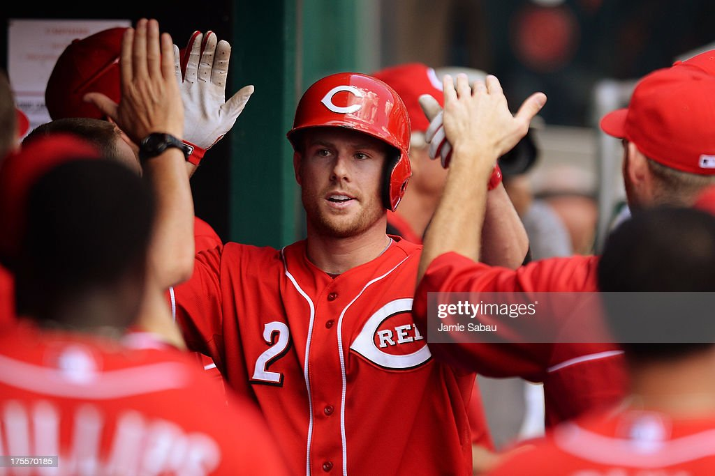 <a gi-track='captionPersonalityLinkClicked' href=/galleries/search?phrase=Zack+Cozart&family=editorial&specificpeople=6889199 ng-click='$event.stopPropagation()'>Zack Cozart</a> #2 of the Cincinnati Reds celebrates his second inning two-run home run against the St. Louis Cardinals at Great American Ball Park on August 4, 2013 in Cincinnati, Ohio.