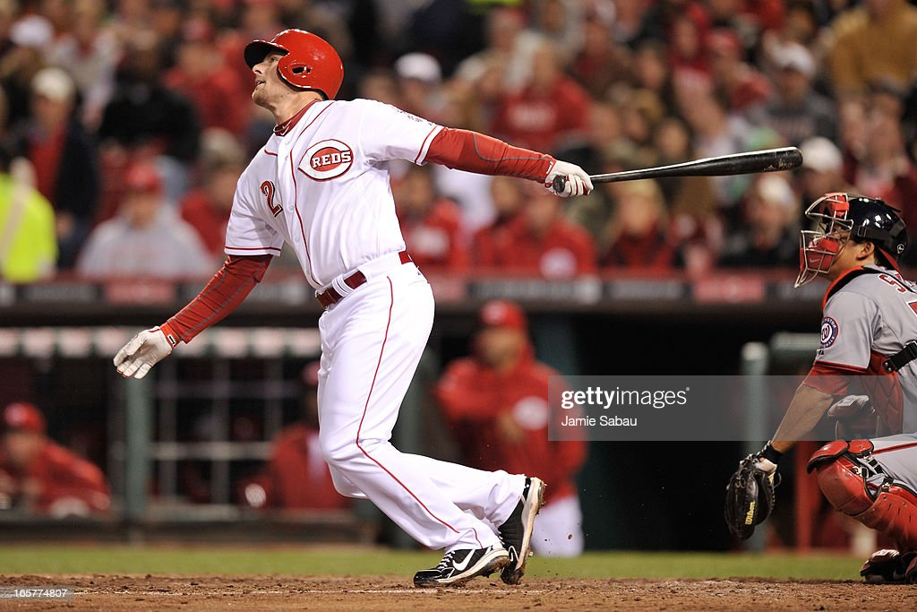 Zack Cozart #2 of the Cincinnati Reds follows through on a sacrifice fly in the fifth inning against the Washington Nationals at Great American Ball Park on April 5, 2013 in Cincinnati, Ohio. Cozart had two of the Reds' six home runs in a 15-0 win over the Nationals.