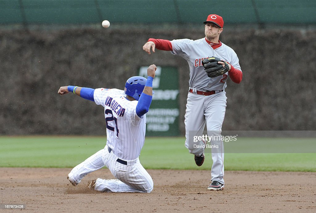 <a gi-track='captionPersonalityLinkClicked' href=/galleries/search?phrase=Zack+Cozart&family=editorial&specificpeople=6889199 ng-click='$event.stopPropagation()'>Zack Cozart</a> #2 of the Cincinnati Reds forces out Luis Valbuena #24 of the Chicago Cubs during the second inning on May 3, 2013 at Wrigley Field in Chicago, Illinois.