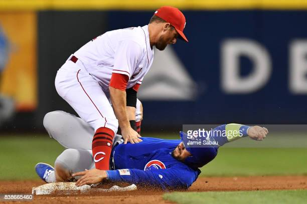 Zack Cozart of the Cincinnati Reds forces out Rene Rivera of the Chicago Cubs at second base to complete a double play in the seventh inning at Great...