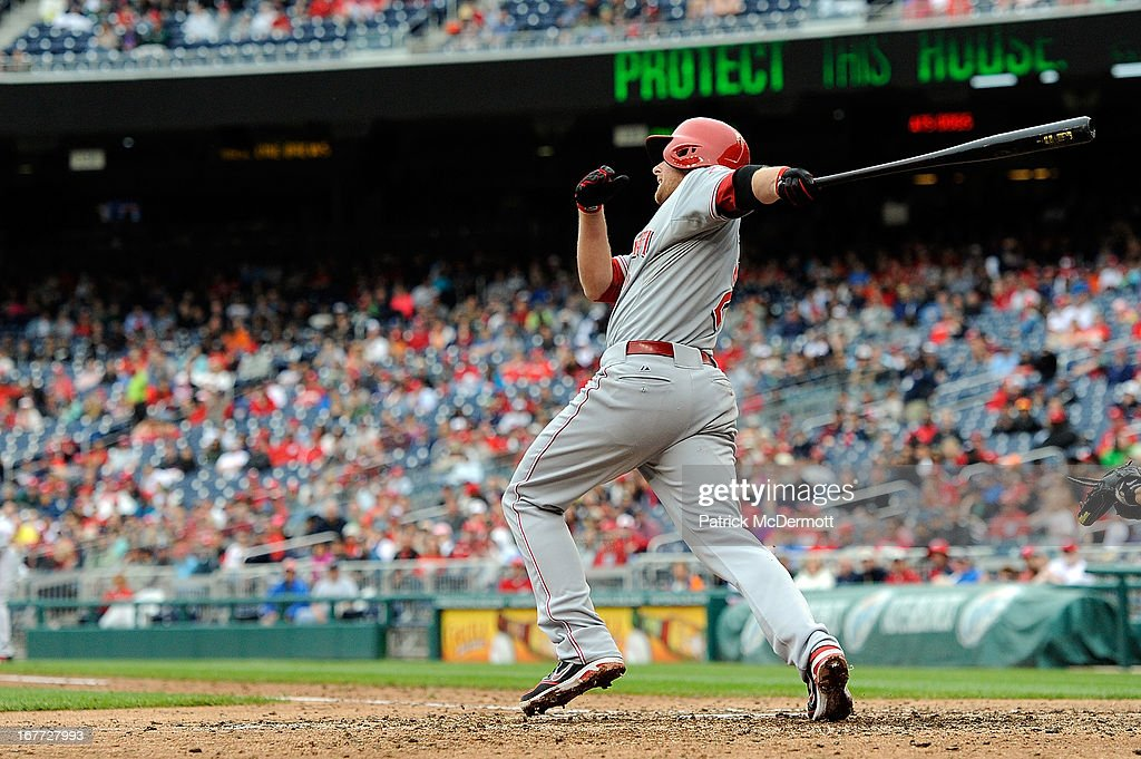 <a gi-track='captionPersonalityLinkClicked' href=/galleries/search?phrase=Zack+Cozart&family=editorial&specificpeople=6889199 ng-click='$event.stopPropagation()'>Zack Cozart</a> #2 of the Cincinnati Reds hits a sacrifice fly ball scoring Corky Miller #37 in the top of the eighth inning during a game against the Washington Nationals at Nationals Park on April 28, 2013 in Washington, DC.