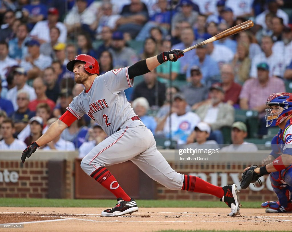 Zack Cozart #2 of the Cincinnati Reds hits a single in the 1st inning against the Chicago Cubs at Wrigley Field on August 15, 2017 in Chicago, Illinois.