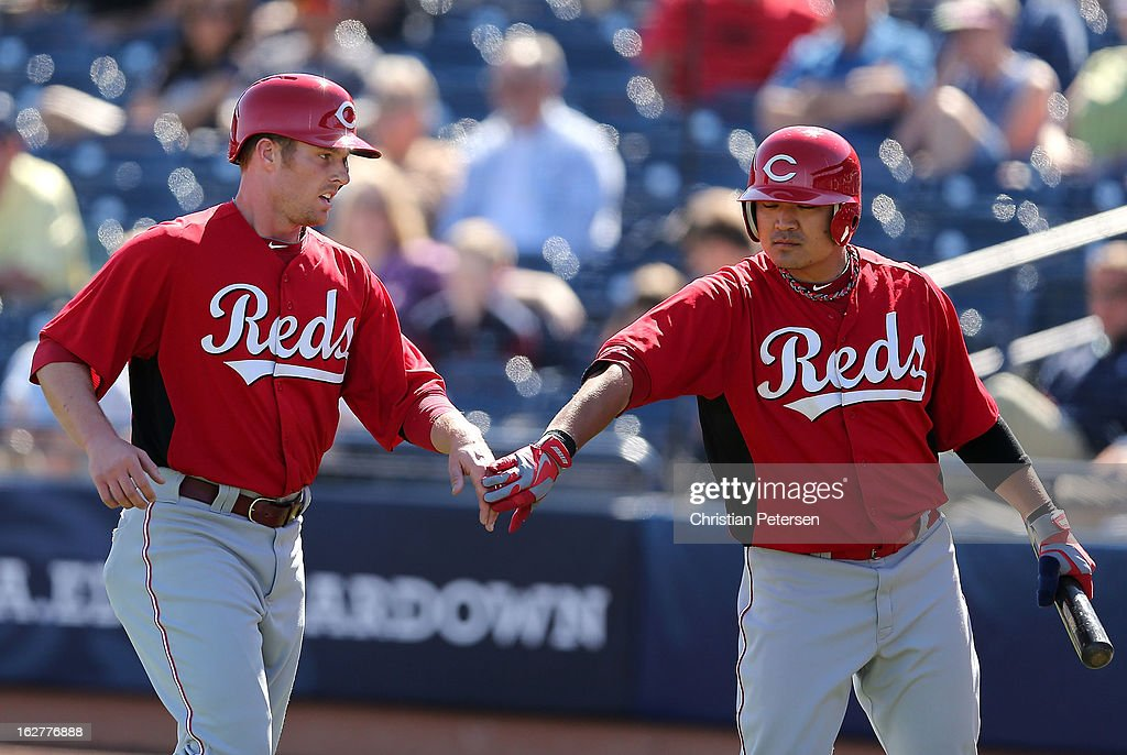 <a gi-track='captionPersonalityLinkClicked' href=/galleries/search?phrase=Zack+Cozart&family=editorial&specificpeople=6889199 ng-click='$event.stopPropagation()'>Zack Cozart</a> #2 (L) of the Cincinnati Reds is congratulated by <a gi-track='captionPersonalityLinkClicked' href=/galleries/search?phrase=Shin-Soo+Choo&family=editorial&specificpeople=196543 ng-click='$event.stopPropagation()'>Shin-Soo Choo</a> #17 after scoring against the San Diego Padres during the third inning of the spring training game at Peoria Stadium on February 26, 2013 in Peoria, Arizona.