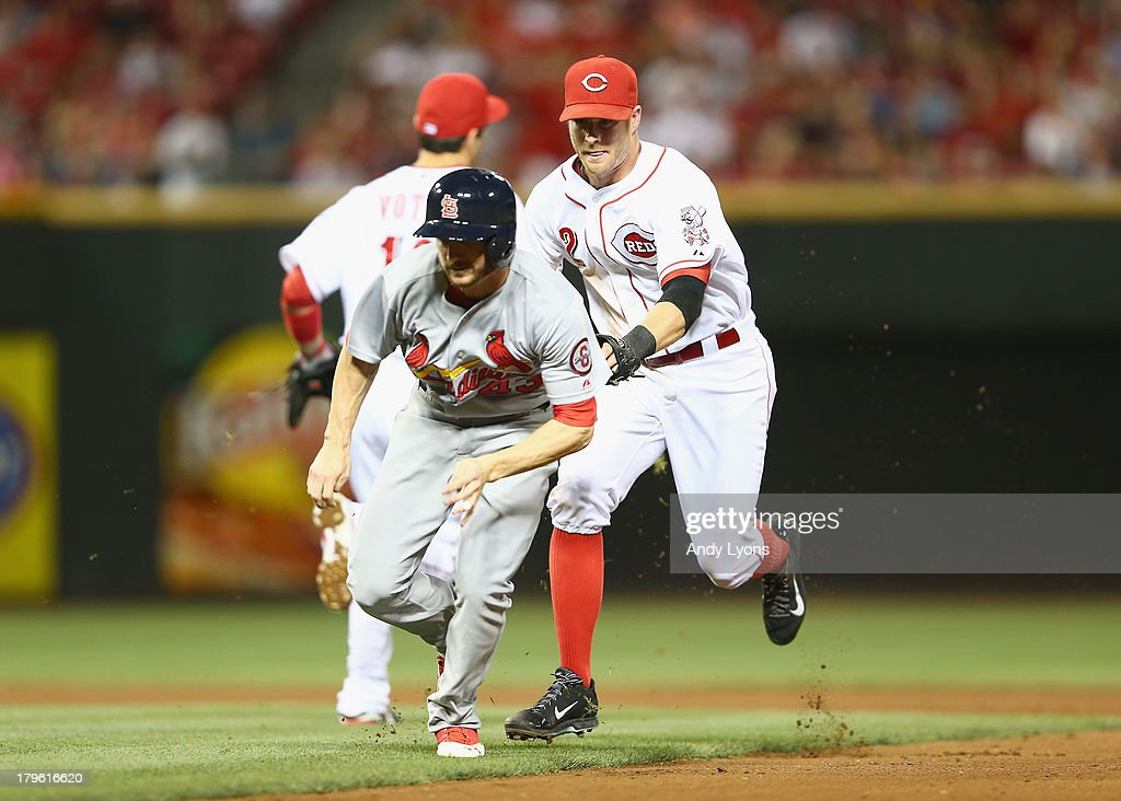 <a gi-track='captionPersonalityLinkClicked' href=/galleries/search?phrase=Zack+Cozart&family=editorial&specificpeople=6889199 ng-click='$event.stopPropagation()'>Zack Cozart</a> #2 of the Cincinnati Reds tags out Shane Robinson #43 of the St. Louis Cardinals during the 4th inning of the game at Great American Ball Park on September 5, 2013 in Cincinnati, Ohio.