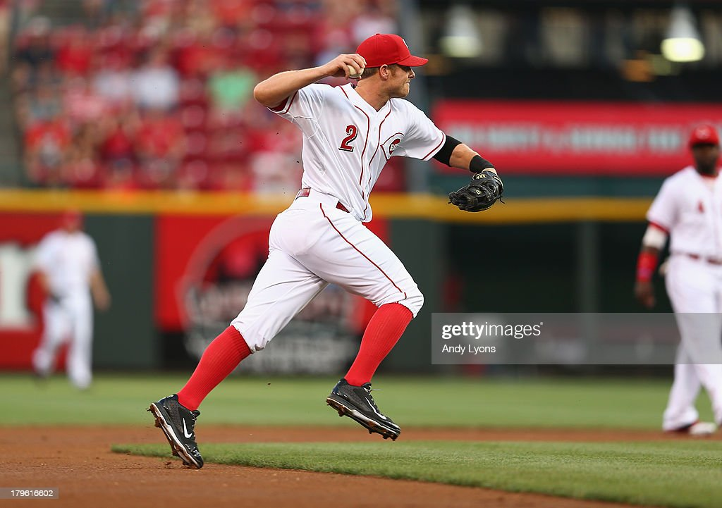<a gi-track='captionPersonalityLinkClicked' href=/galleries/search?phrase=Zack+Cozart&family=editorial&specificpeople=6889199 ng-click='$event.stopPropagation()'>Zack Cozart</a> #2 of the Cincinnati Reds throws the ball to first base during the game against the St. Louis Cardinals at Great American Ball Park on September 5, 2013 in Cincinnati, Ohio.