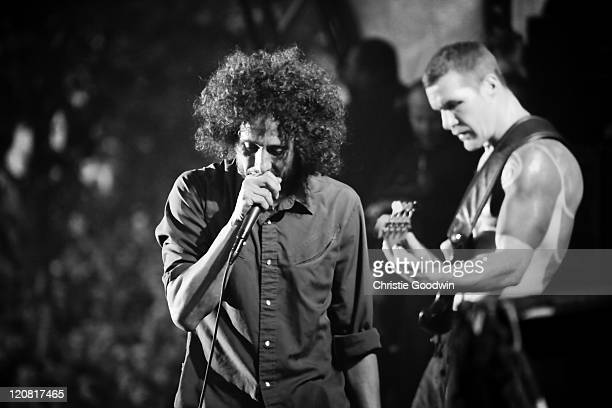 Zack de la Rocha and Tim Commerford of Rage Against The Machine perform on stage in Finsbury Park on June 6 2010 in London UK