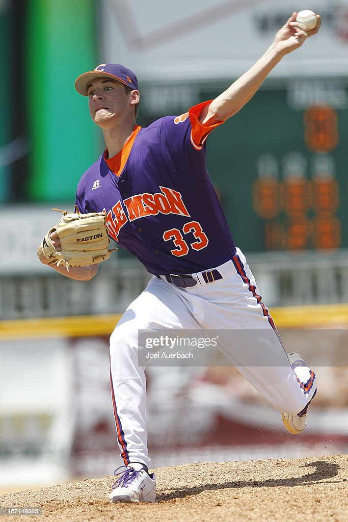 Zack Erwin #33 of the Clemson Tigers throws the ball against the Miami Hurricanes in the bottom of the fourth inning on April 21, 2013 at Alex Rodriguez Park at Mark Light Field in Coral Gables, Florida. Miami defeated Clemson 7-0.