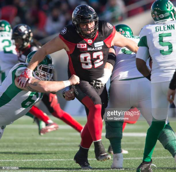 Zack Evans of the Ottawa Redblacks rushes the Saskatchwan Roughriders quarterback in Canadian Football League play during the CFL East Division...