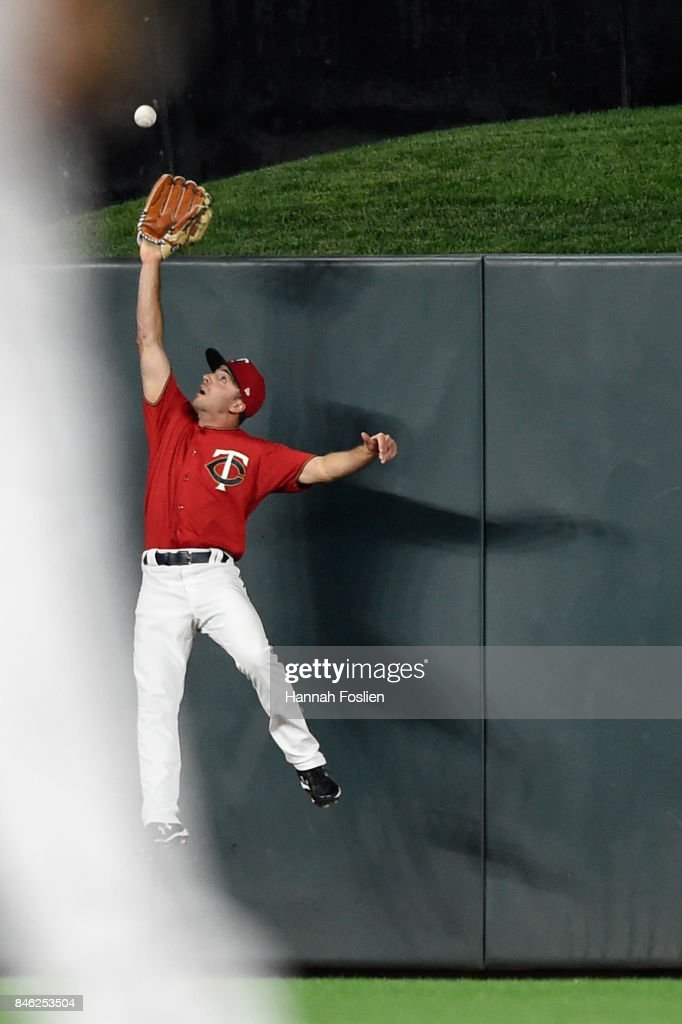 Zack Granite #8 of the Minnesota Twins makes a catch in center field of the ball hit by Wil Myers #4 of the San Diego Padres during the seventh inning of the game on September 12, 2017 at Target Field in Minneapolis, Minnesota. The Twins defeated the Padres 16-0.