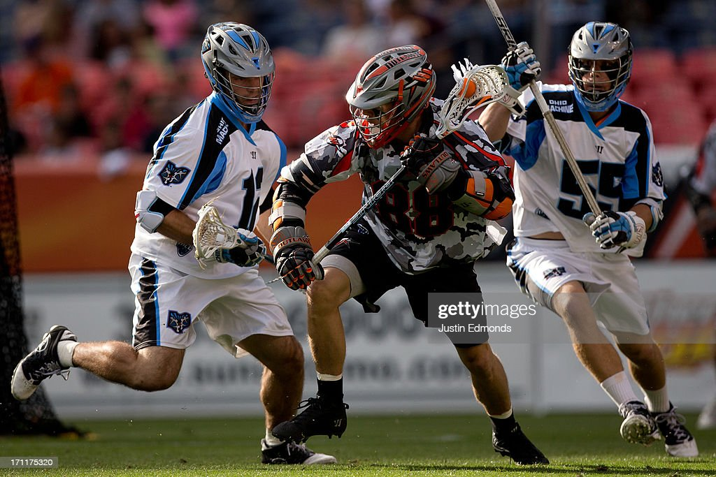 Zack Greer #88 of the Denver Outlaws tries to elude Ray Megill #12 and Chad Wiedmaier #55 of the Ohio Machine during the first quarter at Sports Authority Field at Mile High on June 22, 2013 in Denver, Colorado.