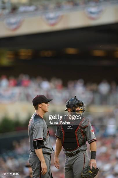 Zack Greinke and Jeff Mathis of the Arizona Diamondbacks speak on the mound during the game against the Minnesota Twins on August 19 2017 at Target...