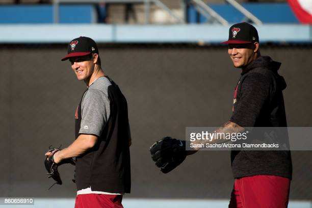 Zack Greinke and Taijuan Walker of the Arizona Diamondbacks smile during workouts the day before Game One of the National League Division Series at...