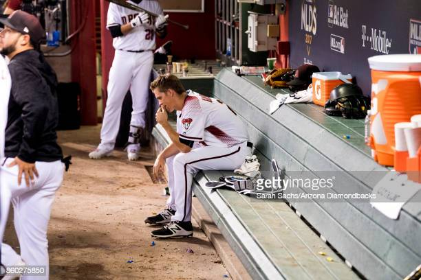 Zack Greinke of the Arizona Diamondbacks hangs out in the dugout during game three of the National League Divisional Series against the Los Angeles...