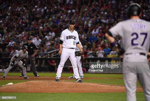 Zack Greinke of the Arizona Diamondbacks looks at baserunner Trevor Story of the Colorado Rockies prior to delivering a pitch during the National...