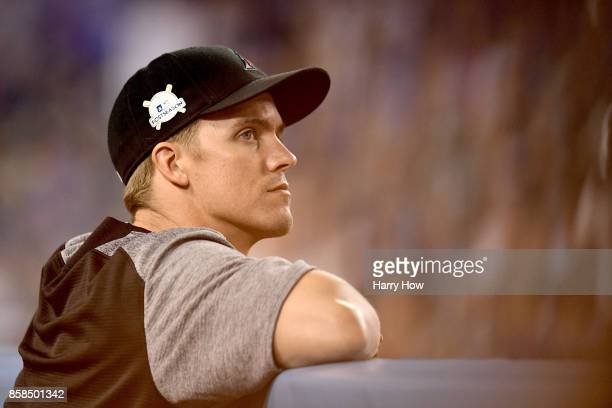 Zack Greinke of the Arizona Diamondbacks looks on from the dugout while taking on the Los Angeles Dodgers in game one of the National League Division...