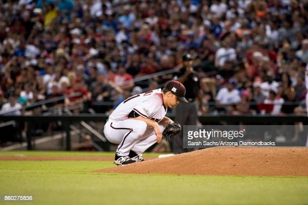 Zack Greinke of the Arizona Diamondbacks prepares to deliver a pitch during game three of the National League Divisional Series against the Los...