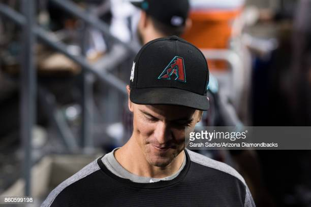 Zack Greinke of the Arizona Diamondbacks smiles in the dugout during game one of the National League Division Series against the Los Angeles Dodgers...