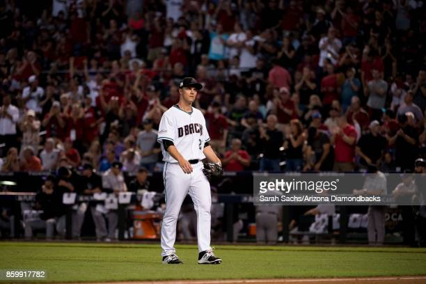Zack Greinke of the Arizona Diamondbacks walks back to the dugout after the top of the 1st inning during the National League Wild Card Game against...
