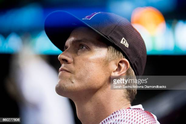 Zack Greinke of the Arizona Diamondbacks watches game three of the National League Divisional Series against the Los Angeles Dodgers from the dugout...