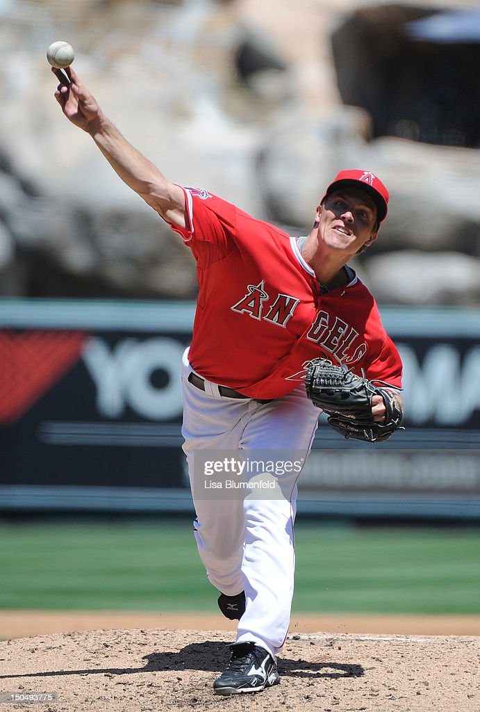 <a gi-track='captionPersonalityLinkClicked' href=/galleries/search?phrase=Zack+Greinke&family=editorial&specificpeople=212804 ng-click='$event.stopPropagation()'>Zack Greinke</a> #23 of the Los Angeles Angels of Anaheim pitches against the Tampa Bay Rays at Angel Stadium of Anaheim on August 19, 2012 in Anaheim, California.
