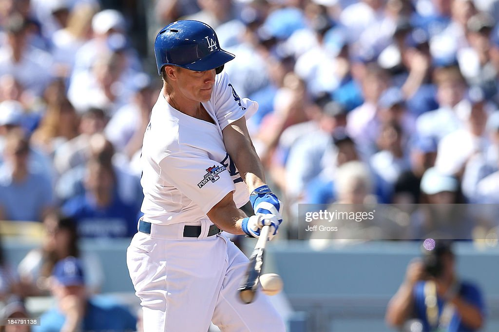 <a gi-track='captionPersonalityLinkClicked' href=/galleries/search?phrase=Zack+Greinke&family=editorial&specificpeople=212804 ng-click='$event.stopPropagation()'>Zack Greinke</a> #21 of the Los Angeles Dodgers hits a RBI single in the second inning against the St. Louis Cardinals in Game Five of the National League Championship Series at Dodger Stadium on October 16, 2013 in Los Angeles, California.