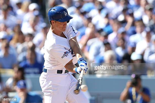 Zack Greinke of the Los Angeles Dodgers hits a RBI single in the second inning against the St Louis Cardinals in Game Five of the National League...